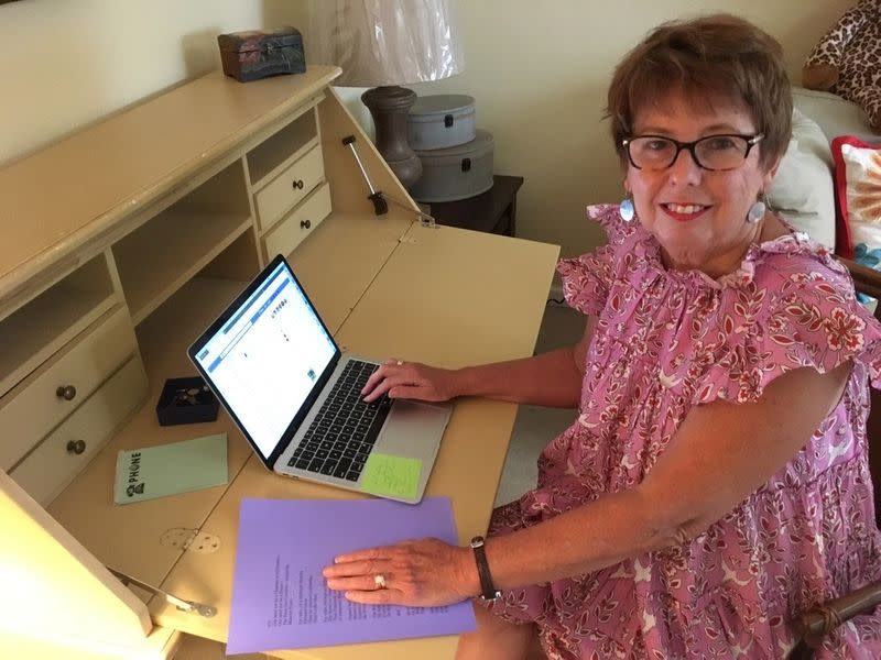 Sylvia Baer, 70, sits at her desk in her home in Fort Lauderdale, Florida