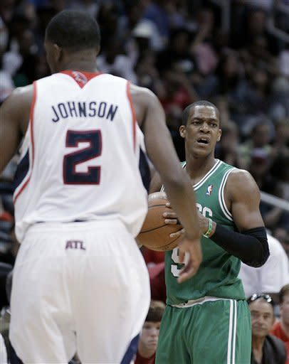Boston Celtics' Rajon Rondo, right, reacts to an official's call in the fourth quarter of Game 1 of an opening-round NBA basketball playoff series against the Atlanta Hawks on Sunday, April 29, 2012, in Atlanta. Atlanta won 83-74. (AP Photo/David Goldman)