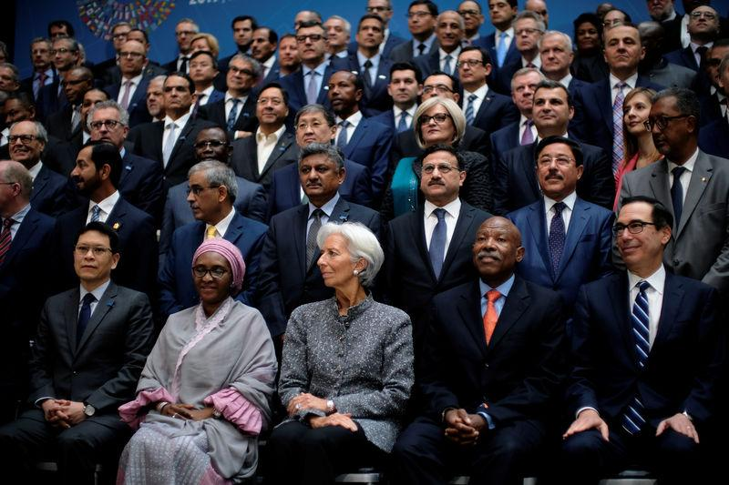 IMF Managing Director Christine Lagarde sits for a group photo with central bank governors at the IMF and World Bank's 2019 Annual Spring Meetings, in Washington