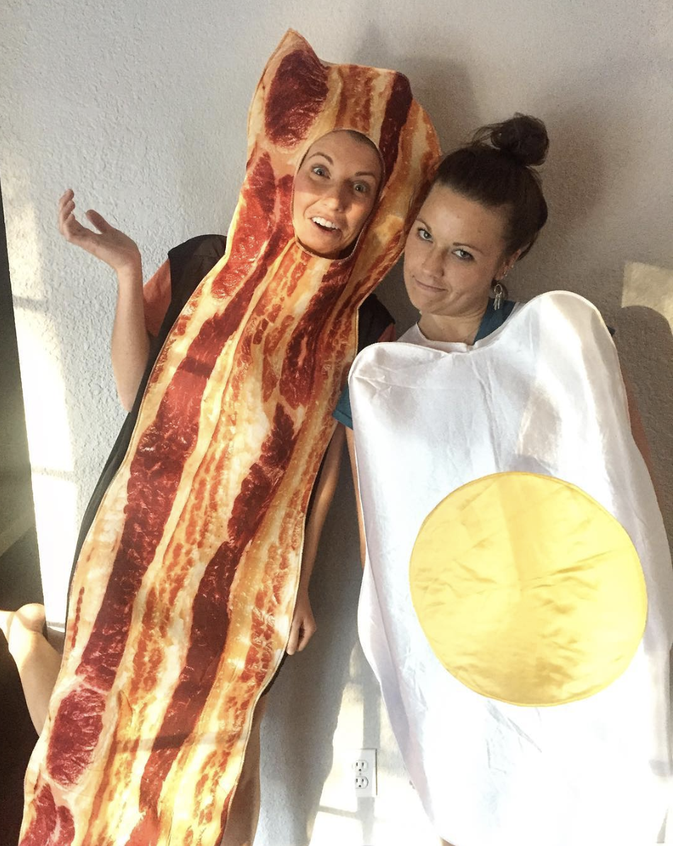 """<p>How do you like your bacon and eggs? Fried with a side of your best pal, no doubt!</p><p><a class=""""link rapid-noclick-resp"""" href=""""https://www.amazon.com/Fun-World-Bacon-Multi-Unisex-Men/dp/B00WQ2L2HA/?tag=syn-yahoo-20&ascsubtag=%5Bartid%7C10072.g.27868790%5Bsrc%7Cyahoo-us"""" rel=""""nofollow noopener"""" target=""""_blank"""" data-ylk=""""slk:Shop Bacon Costume"""">Shop Bacon Costume</a></p>"""