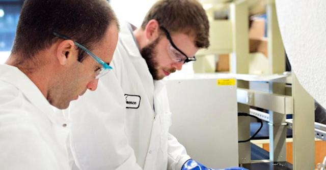 An image of lab technicians provided by Juno Therapeutics.