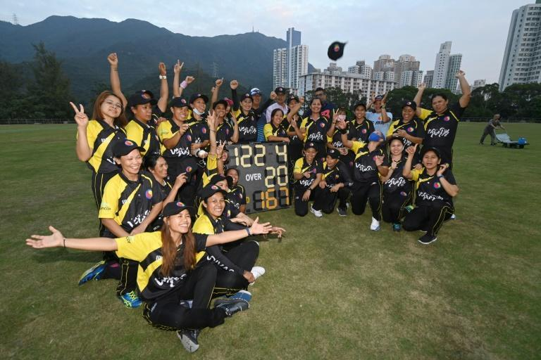 The SCC Divas Cricket Team, made up of domestic helpers from the Philippines, celebrate their lastest win against the Hong Kong Cricket Club Cavaliers