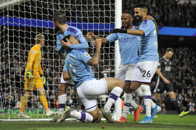 Manchester City's Gabriel Jesus, kneeling, celebrates after scoring his side's third goal during the English Premier League soccer match between Manchester City and Leicester City at Etihad stadium in Manchester, England, Saturday, Dec. 21, 2019. (AP Photo/Rui Vieira)