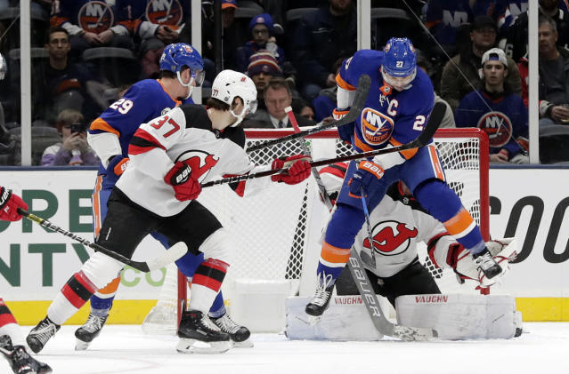 New York Islanders' Anders Lee (27) deflects the puck past New Jersey Devils goaltender Mackenzie Blackwood for a goal during the first period of an NHL hockey game, Thursday, Jan. 17, 2019, in Uniondale, N.Y. (AP Photo/Frank Franklin II)
