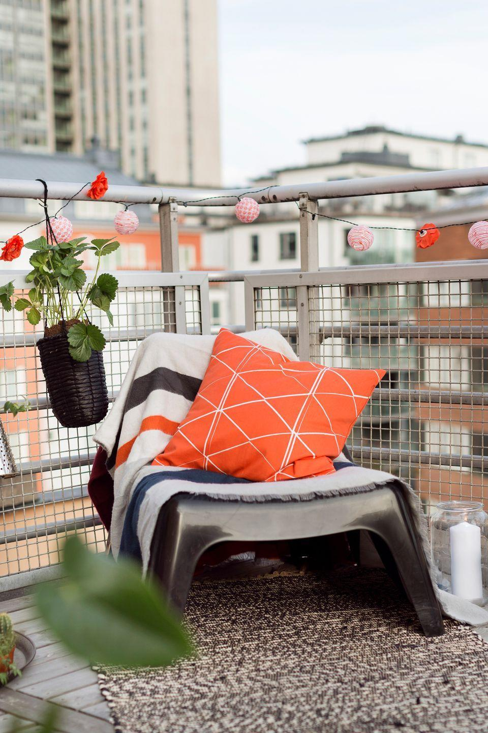 <p>Play up your balcony's casual feel by enveloping it in globe lights. Select a colorful design that will pop against your railings and match the rest of your decor. </p>