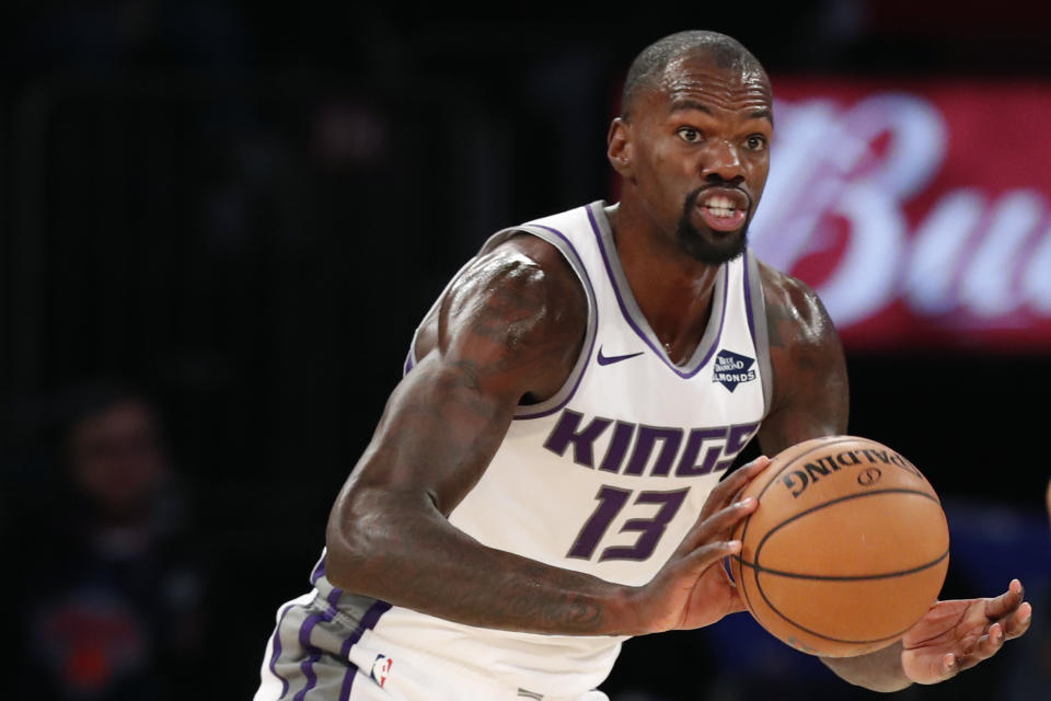 Sacramento Kings center Dewayne Dedmon (13) looks to pass during the second half of an NBA basketball game against the New York Knicks in New York, Sunday, Nov. 3, 2019. The Kings defeated the Knicks 113-92. (AP Photo/Kathy Willens)