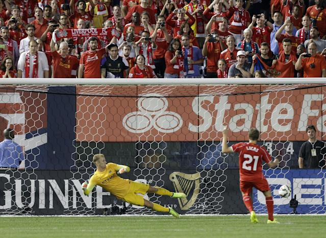 Liverpool's Lucas Leiva (21) scores a goal on a penalty kick as Manchester City's Joe Hart (1) watches the ball during a Guinness International Champions Cup soccer tournament match Wednesday, July 30, 2014, in New York. Liverpool won the game 3-2 in a penalty kick shootout. (AP Photo/Frank Franklin II)