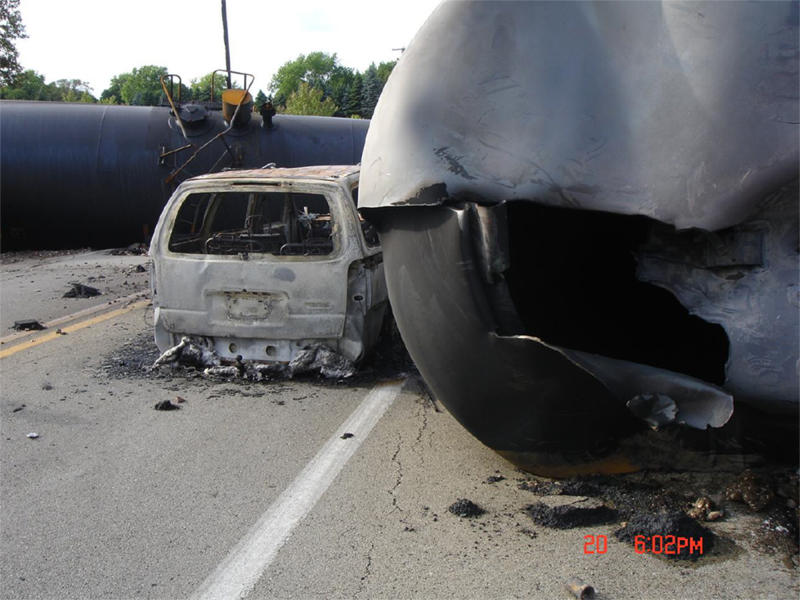 This June 20, 2009 photo provided by the National Transportation Safety Board shows the aftermath of a train derailment near Rockford, Ill. The most common cause of ethanol release in this accident was tank head failure on the tanker seen at right, known as a DOT-111, due to impacts received from couplers and draft sills of adjacent tank cars. For two decades, rail tankers designated as DOT-111, a workhorse of the American rail fleet, have been allowed to haul hazardous liquids from coast to coast even though transportation officials were aware of a dangerous design flaw that almost guarantees the car will tear open in an accident. (AP Photo/National Transportation Safety Board)