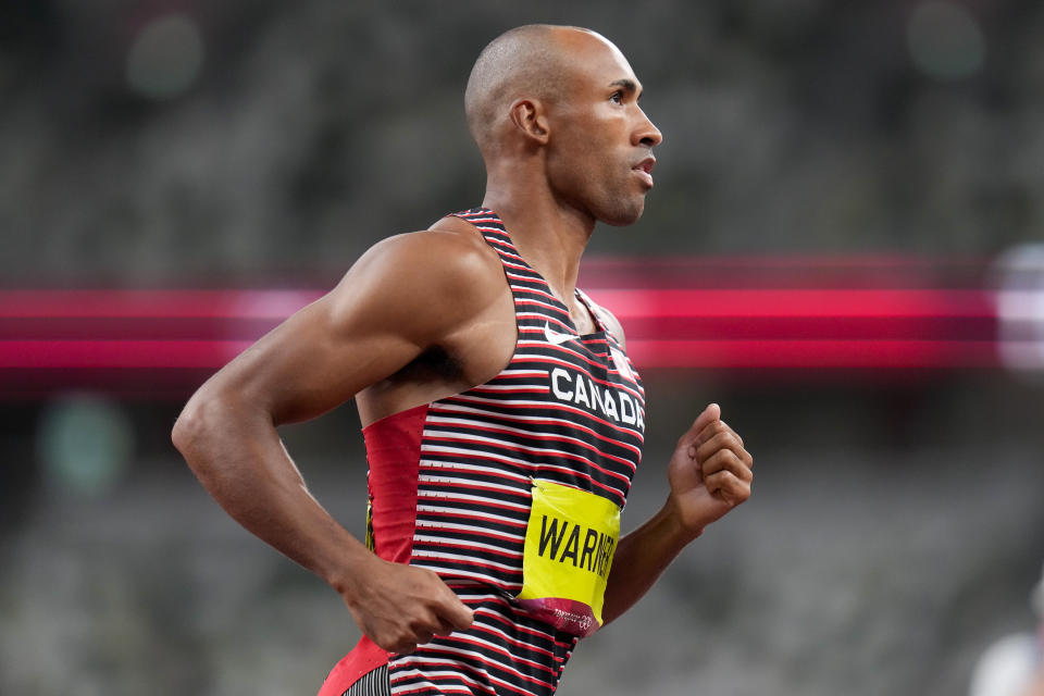 Damian Warner, of Canada, wins the gold medal in the decathlon at the 2020 Summer Olympics, Thursday, Aug. 5, 2021, in Tokyo. (AP Photo/Petr David Josek)