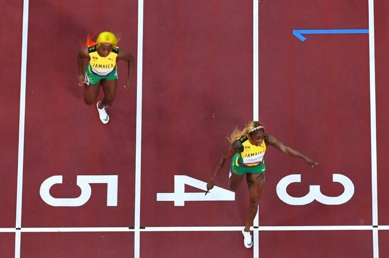 Golden moment: Jamaica's Elaine Thompson-Herah crosses the finish line to win the Olympic Games 100m ahead of compatriot Shelly-Ann Fraser-Pryce