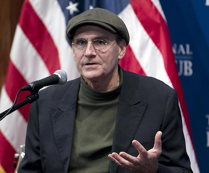 """FILE - This Dec. 7, 2012 file photo shows Grammy Award-winning singer-songwriter James Taylor speaking at National Press Club in Washington. The inaugural committee planning the Jan. 21 event announced Wednesday that Taylor will sing """"America the Beautiful"""" at the swearing-in ceremony on the Capitol's west front and  Kelly Clarkson will perform """"My Country `Tis of Thee"""" . Beyonce will sing the national anthem at President Barack Obama's inauguration ceremony. (AP Photo/Jose Luis Magana, File)"""