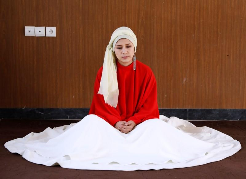 Mirzaie, founder of a Sama Dance group, meditates before dance in Kabul