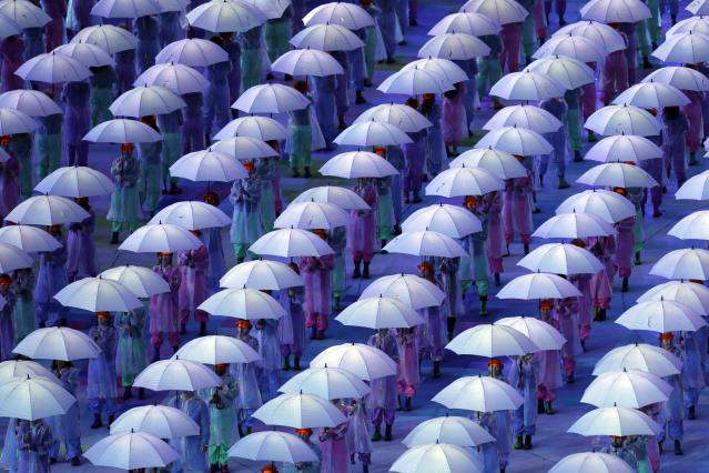 Performers with umbrellas during the Opening Ceremony for the 2012 Paralympics in London, Wednesday Aug. 29, 2012. (AP Photo/Lefteris Pitarakis)
