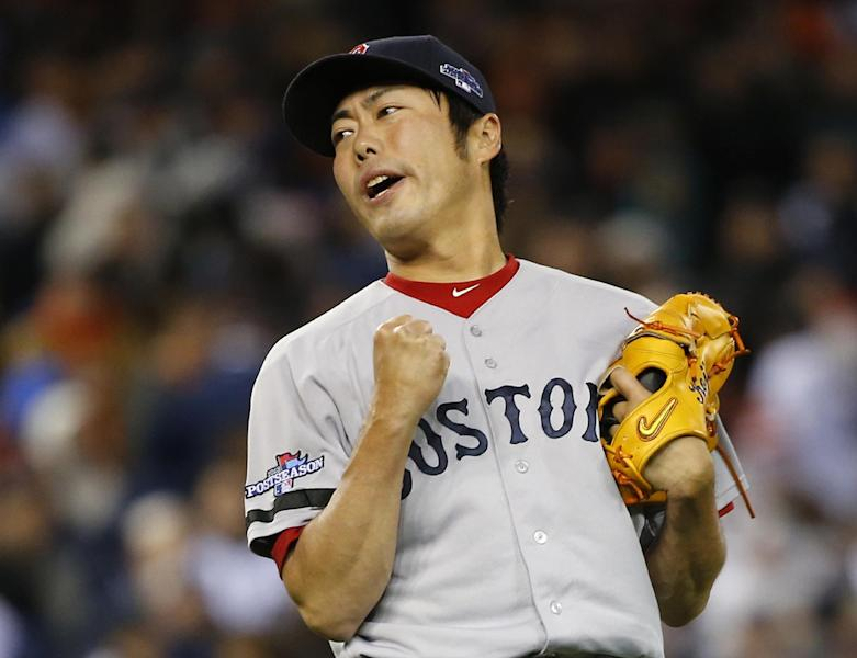Boston Red Sox's Koji Uehara reacts after the Red Sox defeating the Detroit Tigers 4-3 in Game 5 of the American League baseball championship series Thursday, Oct. 17, 2013, in Detroit. (AP Photo/Paul Sancya)