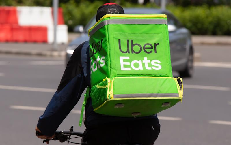 An Uber Eats food delivery courier delivers food in Bucharest, Romania.