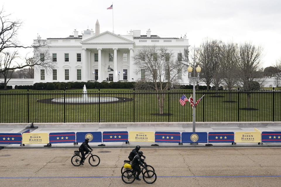 Police work in front of the White House ahead of Inauguration Day ceremonies, Wednesday, Jan. 20, 2021, in Washington. (AP Photo/David J. Phillip)