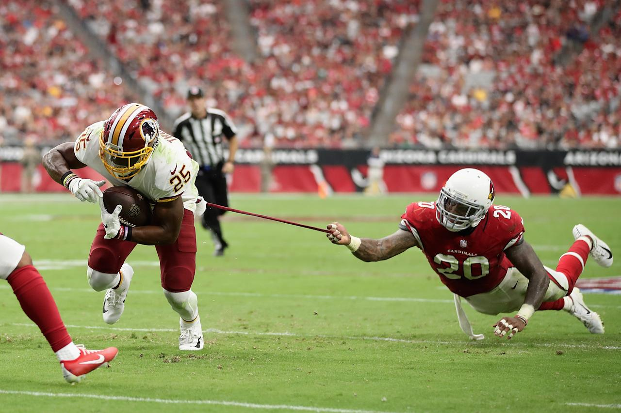 <p>Running back Chris Thompson #25 of the Washington Redskins carries the football as linebacker Deone Bucannon #20 of the Arizona Cardinals attempts a tackle during the first half of the NFL game at State Farm Stadium on September 9, 2018 in Glendale, Arizona. (Photo by Christian Petersen/Getty Images) </p>