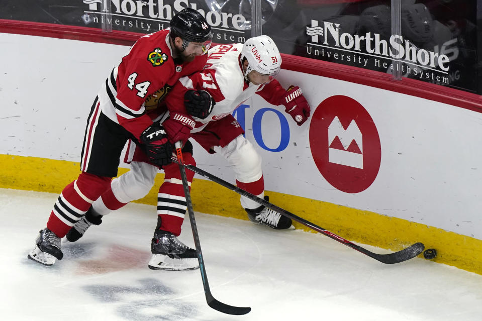 Chicago Blackhawks defenseman Calvin de Haan, left, and Detroit Red Wings center Valtteri Filppula vie for the puck during the third period of an NHL hockey game in Chicago, Saturday, Feb. 27, 2021. (AP Photo/Nam Y. Huh)