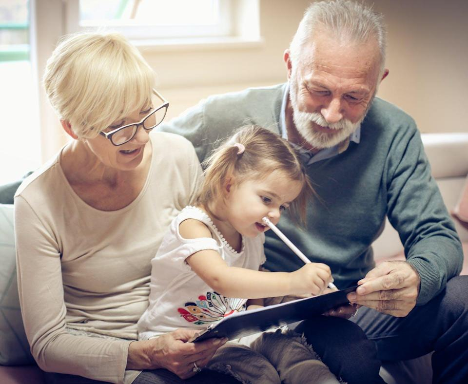 """<span class=""""caption"""">Family members' involvement in encouraging children's reading and writing in everyday play and family life can make a difference to children's literacy achievement.</span> <span class=""""attribution""""><span class=""""source"""">(Shutterstock)</span></span>"""