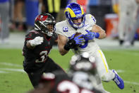 Los Angeles Rams wide receiver Cooper Kupp (10) eludes a tackle by Tampa Bay Buccaneers strong safety Antoine Winfield Jr. (31) after a catch during the first half of an NFL football game Monday, Nov. 23, 2020, in Tampa, Fla. (AP Photo/Mark LoMoglio)