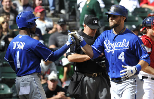 Kansas City Royals' Jarrod Dyson (1) celebrates with teammate Alex Gordon (4) after Gordon's two-run home run against the Chicago White Sox during the 12th inning of a baseball game on Sunday, July 28, 2013, in Chicago. (AP Photo/Jim Prisching)