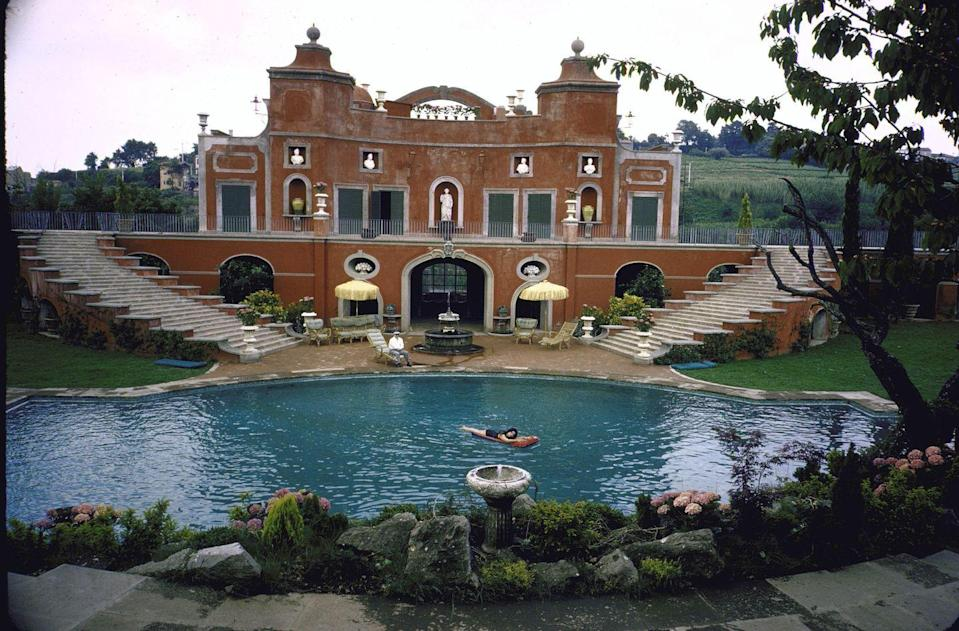 <p>Almost as impressive as the rooms in the villa were the grounds of the estate. Sophia's property included an orchard and a 135-foot swimming pool, complete with a grand pool house, photographed here. </p>