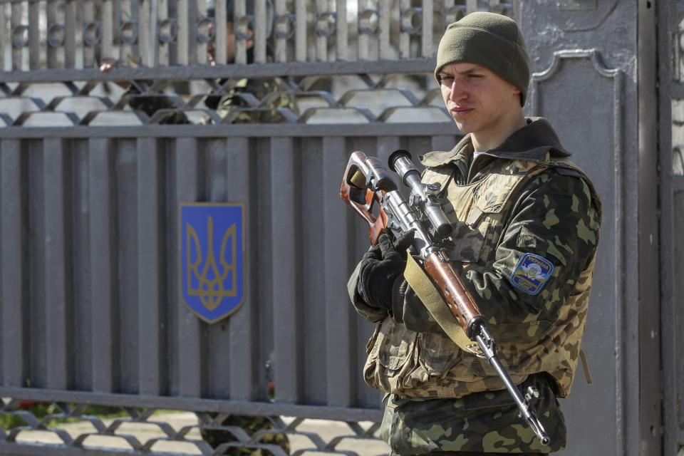 A Ukrainian serviceman stands guard during a military drill near the city of Mykolaiv, also known as Nikolayev, in southern Ukraine, northwest of the Crimean peninsula March 14, 2014. REUTERS/Valentyn Ogirenko