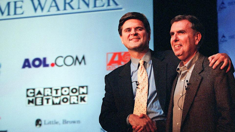 Steve Case, Gerald Levin, AOL, Time Warner Then AOL chairman and chief executive, Steve Case, left, and Time Warner's the chairman and chief executive, Gerald Levin, shake hands before a news conference to announce the merger of the two companies, in New York.