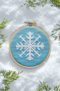 """<p>Use our <a href=""""https://www.countryliving.com/diy-crafts/a6380/cross-stitch/"""" rel=""""nofollow noopener"""" target=""""_blank"""" data-ylk=""""slk:free cross stitch pattern"""" class=""""link rapid-noclick-resp"""">free cross stitch pattern</a> to make this work of art as you relax by the fireplace.</p><p><strong>Get the pattern <a href=""""http://clv.h-cdn.co/assets/downloads/1509720897_-_snowflake-cross-stitch-pattern.pdf"""" rel=""""nofollow noopener"""" target=""""_blank"""" data-ylk=""""slk:here"""" class=""""link rapid-noclick-resp"""">here</a>.</strong></p><p><a class=""""link rapid-noclick-resp"""" href=""""https://www.amazon.com/Similane-Pieces-Embroidery-Bamboo-Circle/dp/B07CV96FQV/ref=sr_1_1_sspa?tag=syn-yahoo-20&ascsubtag=%5Bartid%7C10050.g.23489557%5Bsrc%7Cyahoo-us"""" rel=""""nofollow noopener"""" target=""""_blank"""" data-ylk=""""slk:SHOP EMBROIDERY HOOPS"""">SHOP EMBROIDERY HOOPS</a><strong><br></strong></p>"""