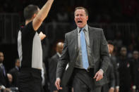 Portland Trail Blazers head coach Terry Stotts, right, shouts at referee Kane Fitzgerald before being called for a technical foul during the first half of an NBA basketball game against the Atlanta Hawks, Saturday, Feb. 29, 2020, in Atlanta. (AP Photo/John Amis)