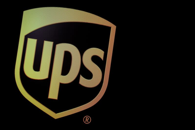 The company logo for United Parcel Service (UPS), is displayed on a screen at the NYSE in New York