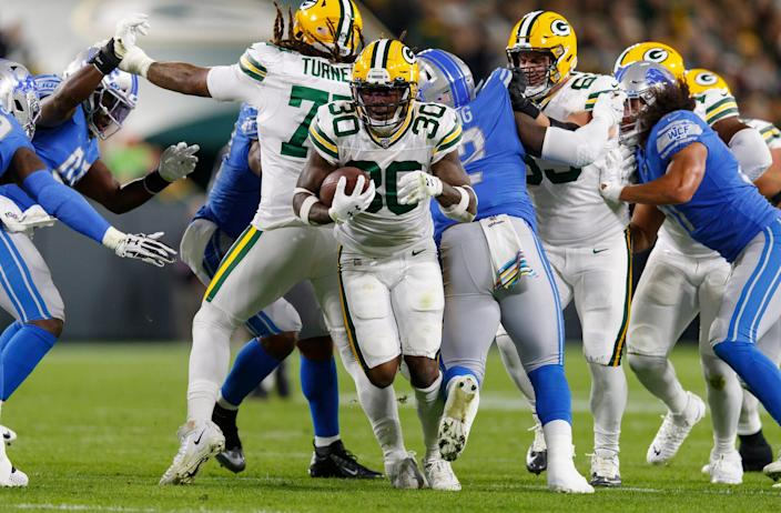 Green Bay Packers running back Jamaal Williams rushes with the football during the second quarter against the Detroit Lions at Lambeau Field in Green Bay, Wis., Oct. 14, 2019.