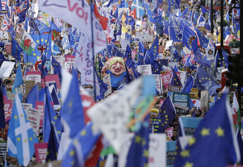 """Anti-Brexit remain in the European Union supporters take part in a """"People's Vote"""" protest march calling for another referendum on Britain's EU membership, in London, Saturday, Oct. 19, 2019. Britain's Parliament is set to vote in a rare Saturday sitting on Prime Minister Boris Johnson's new deal with the European Union, a decisive moment in the prolonged bid to end the Brexit stalemate. Various scenarios may be put in motion by the vote. (AP Photo/Matt Dunham)"""