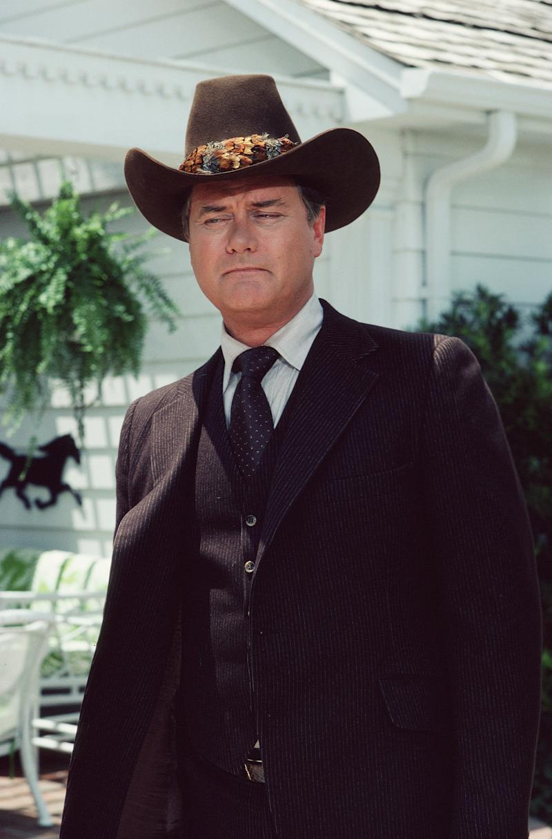A promotional still from the American television series 'Dallas' shows Larry Hagman (as John Ross 'J.R.' Ewing, Jr.), dressed in a darkcolored three-piece suit and matching Stetson, May 1983. (Photo by CBS Photo Archive/Getty Images)
