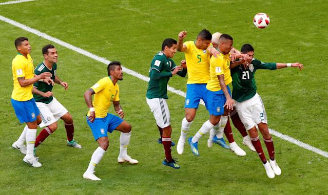 <p>Brazil's Casemiro and Gabriel Jesus in action with Mexico's Edson Alvarez REUTERS/David Gray </p>