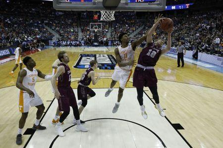 Mar 22, 2019; Columbus, OH, USA; Colgate Raiders forward Will Rayman (10) collect a rebound in front of Tennessee Volunteers forward Kyle Alexander (11) in the second half in the first round of the 2019 NCAA Tournament at Nationwide Arena. Mandatory Credit: Rick Osentoski-USA TODAY Sports