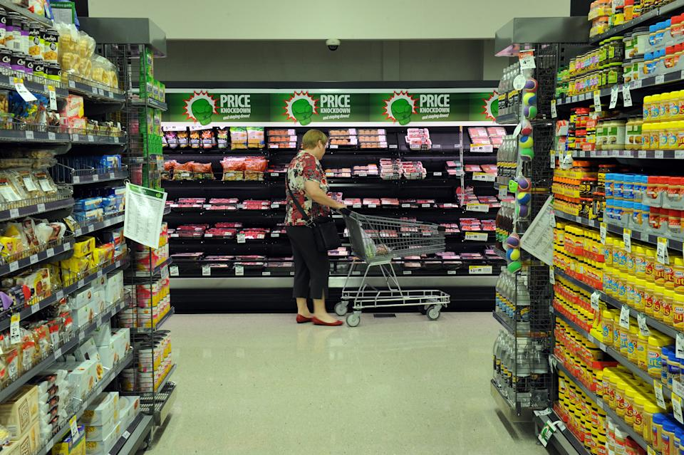 A shopper looks at the meat section inside a Woolworths grocery store in Brisbane.