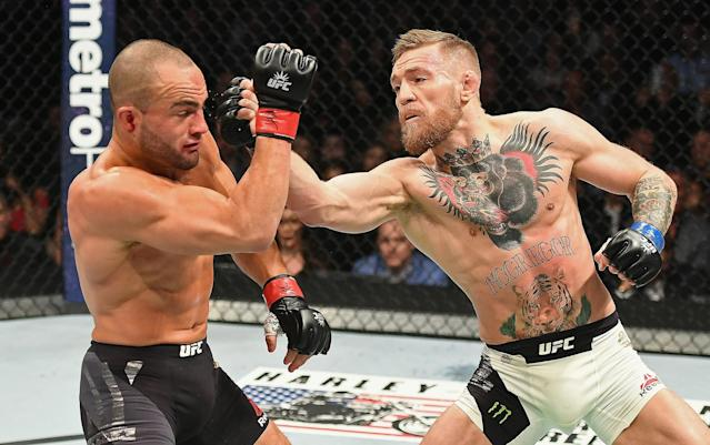 Eddie Alvarez fights against Conor McGregor in their lightweight championship bout during the UFC 205 event at Madison Square Garden on Nov. 12, 2016, in New York. (Getty Images)