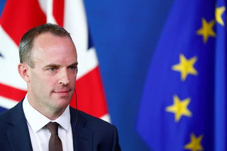 Britain's Secretary of State for Exiting the European Union, Dominic Raab looks on as he attends a media briefing with European Union's chief Brexit negotiator, Michel Barnier, after a meeting at the EU Commission headquarters in Brussels