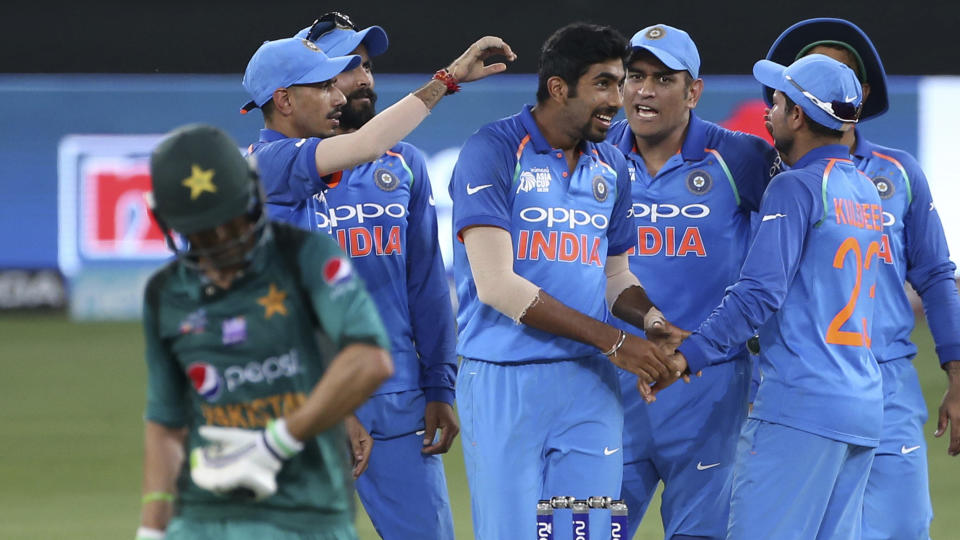 According to Irfan Pathan, Jasprit Bumrah (centre) will be Virat Kohli's 'trump card' in England.