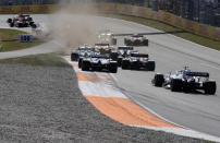 Red Bull driver Max Verstappen of the Netherlands leads at the start of the Formula One Dutch Grand Prix, at the Zandvoort racetrack, Netherlands, Sunday, Sept. 5, 2021. (AP Photo/Peter Dejong)