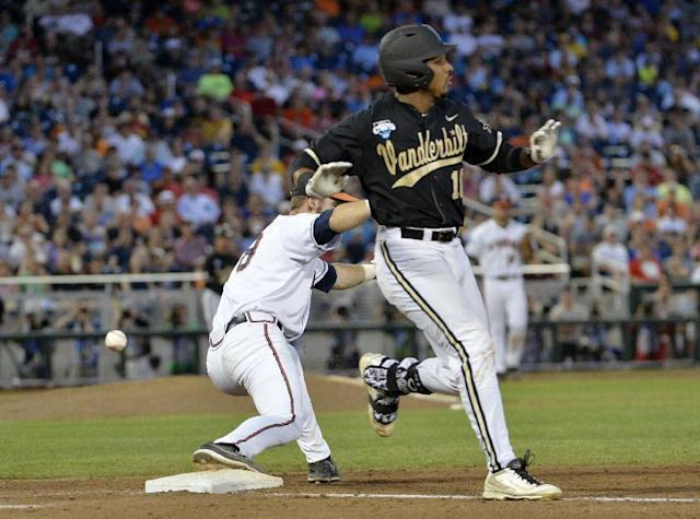 Vanderbilt's John Norwood (10) arrives at first with a single as Virginia first baseman Mike Papi (38) misses the throw during the sixth inning of Game 3 of the best-of-three NCAA baseball College World Series finals in Omaha, Neb., Wednesday, June 25, 2014. Norwood advanced to second. (AP Photo/Ted Kirk)