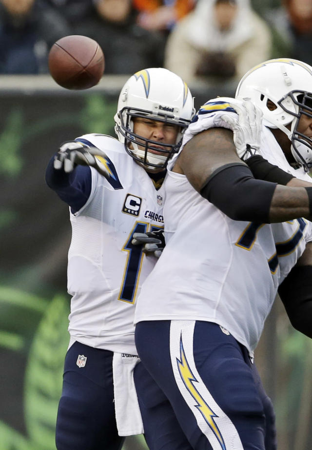 San Diego Chargers quarterback Philip Rivers fires a pass against the Cincinnati Bengals in the second half of an NFL wild-card playoff football game on Sunday, Jan. 5, 2014, in Cincinnati. (AP Photo/David Kohl)