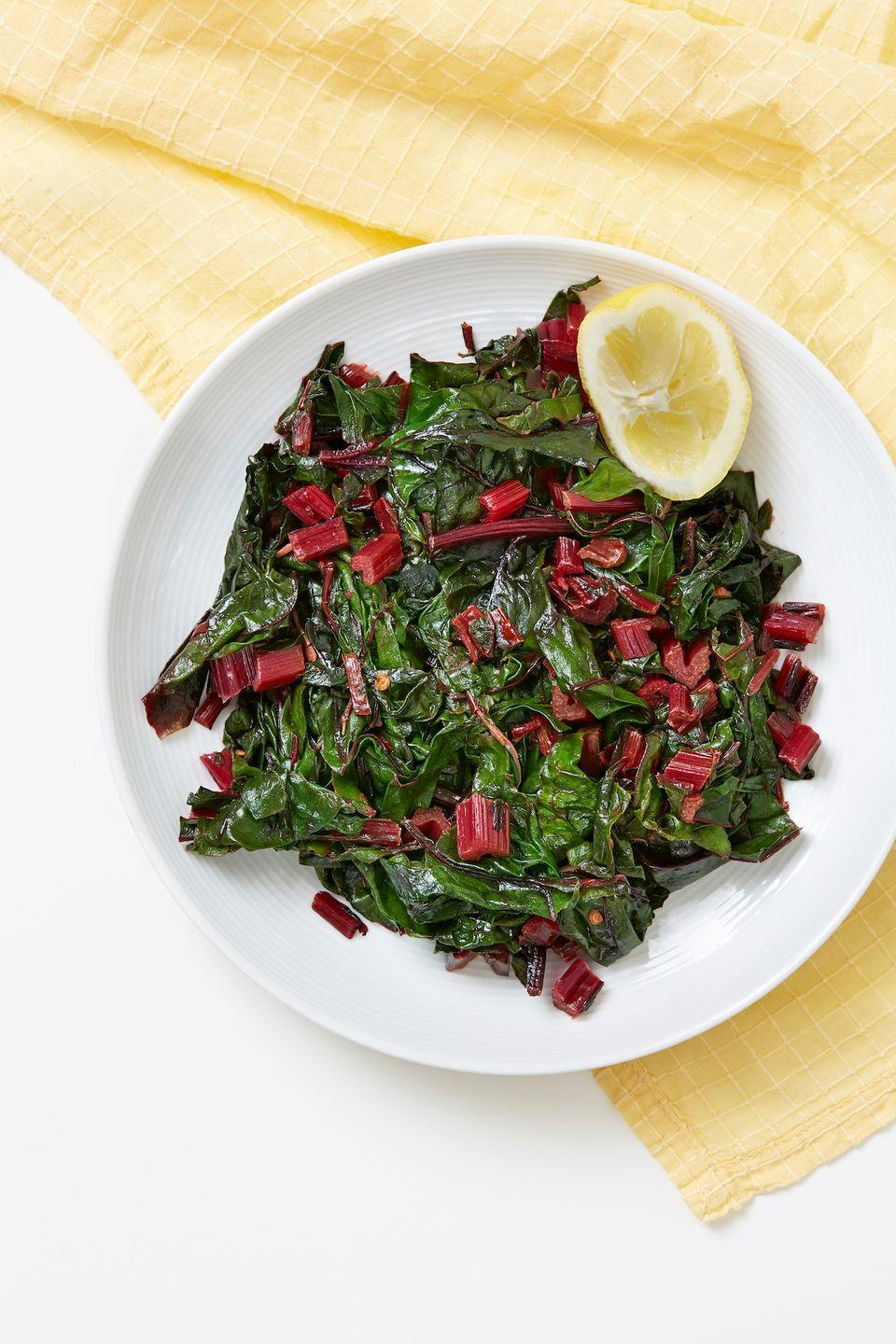 """<p>This might become your new go-to veggie side.</p><p>Get the recipe form <a href=""""https://www.delish.com/cooking/recipe-ideas/a32392605/swiss-chard-recipe/"""" rel=""""nofollow noopener"""" target=""""_blank"""" data-ylk=""""slk:Delish"""" class=""""link rapid-noclick-resp"""">Delish</a>. </p>"""