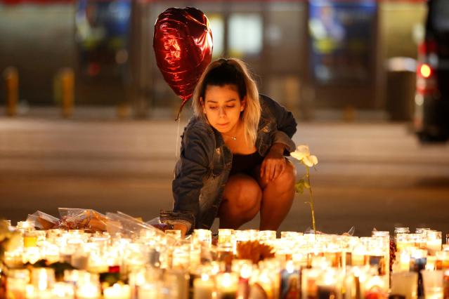<p>A woman lights candles at a vigil on the Las Vegas strip following a mass shooting at the Route 91 Harvest Country Music Festival in Las Vegas, Nevada, U.S., October 2, 2017. (Photo: Chris Wattie/Reuters) </p>