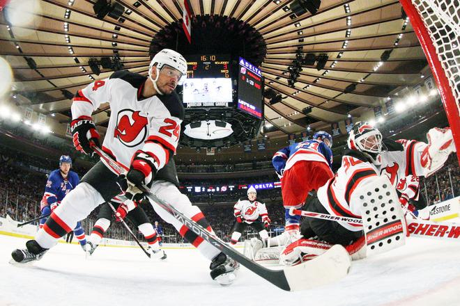 NEW YORK, NY - MAY 23:  Bryce Salvador #24 and Martin Brodeur #30 of the New Jersey Devils defend against the New York Rangers in the second period of Game Five of the Eastern Conference Final during the 2012 NHL Stanley Cup Playoffs at Madison Square Garden on May 23, 2012 in New York City.  (Photo by Bruce Bennett/Getty Images)