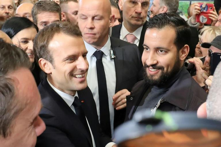 French President Emmanuel Macron pictured in February with his bodyguard Alexandre Benalla, who was caught on video roughing up protesters while wearing a police helmet