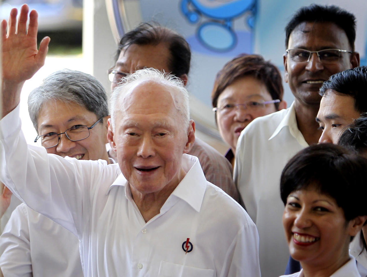 FILE - In this April 27, 2011 file photo, Singapore's Minister Mentor Lee Kuan Yew waves to supporters as he arrives at an elections nomination center in Singapore. Singapore founding father Lee Kuan Yew resigned from the Cabinet on Saturday, May 14, 2011, ceding leadership to a younger generation after his party's worst election result since independence in 1965.
