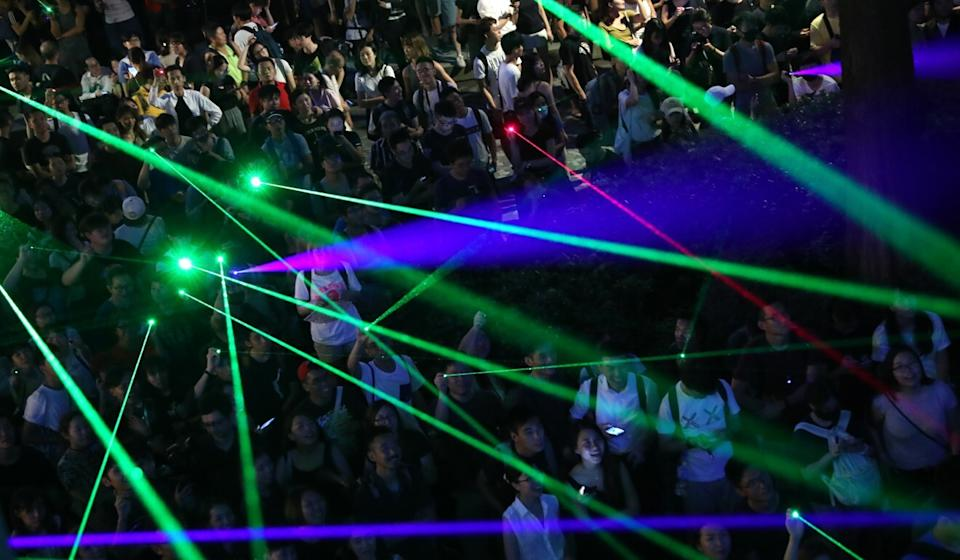 Protesters shine their laser pointers at the Hong Kong Space Museum, in Tsim Sha Tsui, in August last year. Photo: Sam Tsang