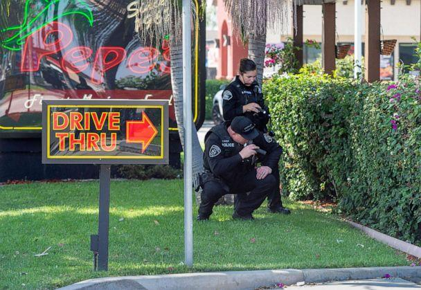 PHOTO: Police investigate the scene where a retired Cal State Fullerton administrator was stabbed to death, Aug. 19, 2019 in Fullerton, Calif. (Paul Bersebach/The Orange County Register via AP)